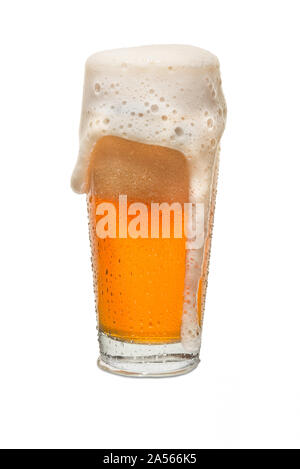 Sweated Craft Pub Beer Glass Overflowing with Beer #2. - Stock Photo