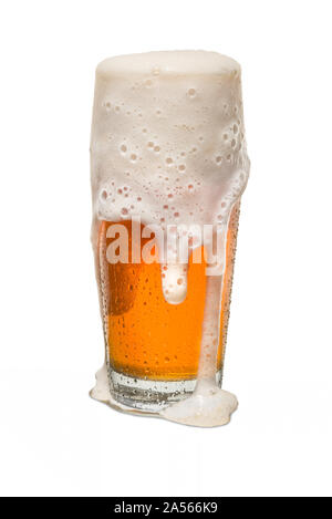 Sweated Craft Pub Beer Glass Overflowing with Beer #3. - Stock Photo
