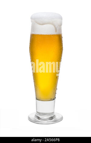 Classic Pilsner Beer with Condensation, with Foam Head and Drip Running Over Rim. - Stock Photo