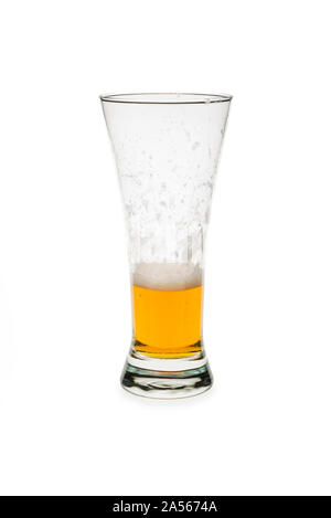 Partly consumed beer in a pilsner glass isolated against white background. - Stock Photo