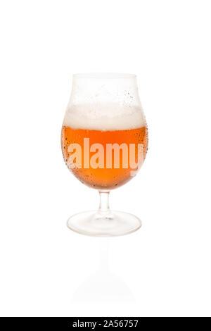 Half Empty Tulip Glass of Belgium Beer. - Stock Photo