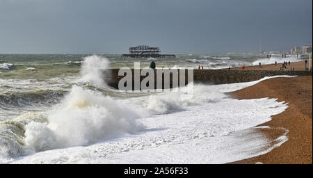 Brighton UK 18th October 2019 - Waves crash in on Brighton seafront as a mixture of strong winds rain showers and sunshine sweep along the south coast as the unsettled weather continues throughout Britain . Credit: Simon Dack / Alamy Live News - Stock Photo