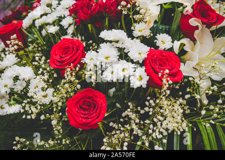 Large Beautiful bouquet of mixed flowers. Floral shop concept . Beautiful fresh cut bouquet. Flowers delivery. red e roses in a bouquet - Stock Photo