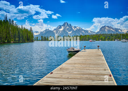 Motoboat dock on Jackson Lake at Coulter Bay. - Stock Photo