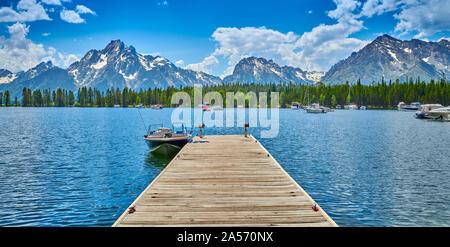 Motoboat dock on Jackson Lake at Coulter Bay. - Stock Photo