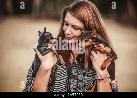 woman with Prague Ratter - Stock Photo