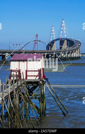 Carrelet and the St-Nazaire Bridge / Le pont de Saint-Nazaire, cable-stayed bridge spanning the Loire River, Loire-Atlantique, France - Stock Photo