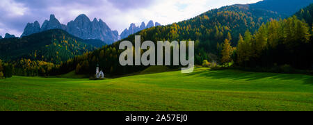 Valley with a church and mountains in the background, Santa Maddalena, Val De Funes, Le Odle, Dolomites, Italy - Stock Photo
