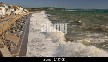 Waves breaking over the seafront at Torcross, Devon (Slapton Sands). - Stock Photo