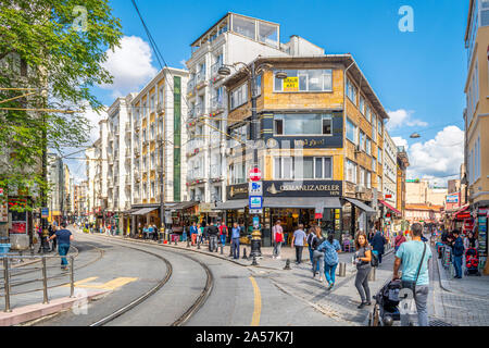 Tourists and local Turks enjoy a summer day in the Sultanahmet district of shops and cafes in Istanbul, Turkey. - Stock Photo