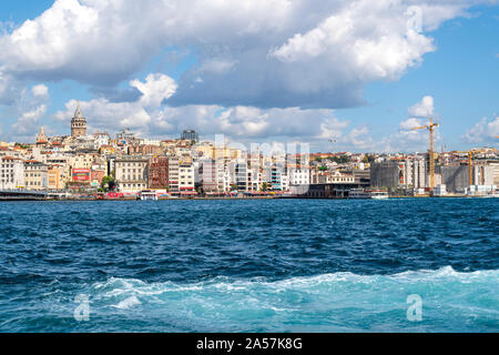 A view of the ancient Galata Tower, the Galata Bridge, the Bosphorus river and skyline of Istanbul, Turkey at the Golden Horn. - Stock Photo