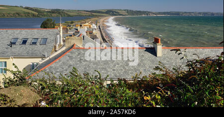 Waves breaking over the seafront at Torcross, Devon (looking along Slapton Sands). - Stock Photo