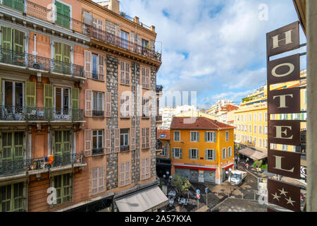 View from a hotel balcony overlooking the touristic urban center of Nice France on the French Riviera. - Stock Photo