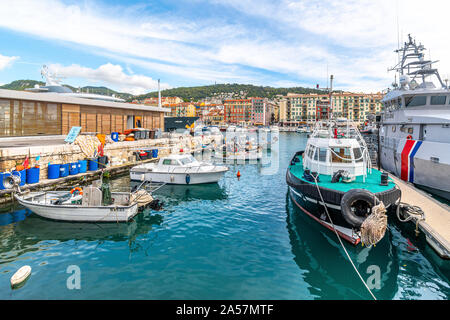An assortment of boats and watercraft in the old harbor of Port Lympia in the city of Nice France, on the Mediterranean Sea at the French Riviera. - Stock Photo