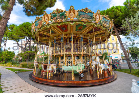The colorful carousel at Albert I Garden, or Jardin Albert 1er in Vieux or Old City in the Mediterannean city of Nice France on the French Riviera - Stock Photo