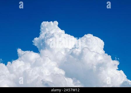 White fluffy Cumulonimbus clouds against a blue sky, Paphos, Cyprus. - Stock Photo