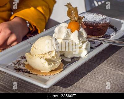 Souffle with vanilla ice cream and whipped cream - Stock Photo