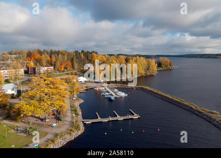 Puumala, Finland–October 5, 2019: Top view of The Saimaa Lake with boats on the pier and residential buildings in autumn. Puumala Municipality - Stock Photo