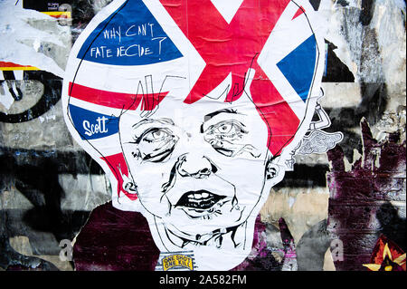 London, UK. 18th Oct, 2019. A sticker of Theresa May is seen on a wall.As the Brexit deadline looms, new murals and paste-ups appear on the streets of London. Brick Lane, in London's east end, is one of the most popular places to find all kind of art around the Brexit. Also in the famous district of Shoreditch, tourists walk and take photos around this political street art. Credit: Ana Fernandez/SOPA Images/ZUMA Wire/Alamy Live News - Stock Photo