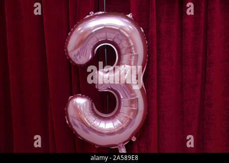 Pink balloon and thirty years old celebration - Stock Photo
