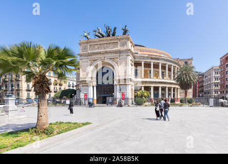 Palermo, Sicily - Marc 23, 2019: Teatro Politeama Palermo, Politeama Theatre front view from the side in daylight  with people passing by. - Stock Photo