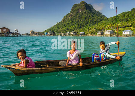 Nomad girls playing with boat near their village. - Stock Photo