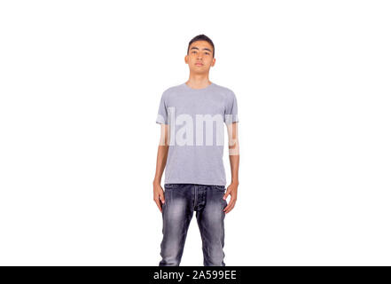 The  young Thai man in short hair style with gray shirt stands showing his  bored face - Stock Photo