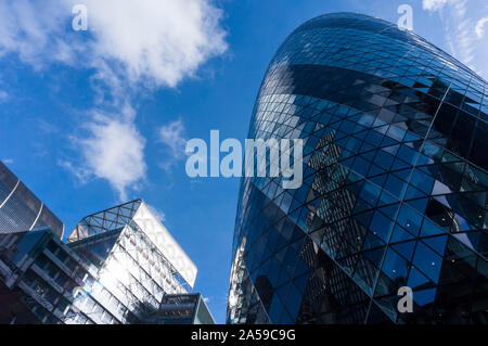 Close up view of city skyscrapers. 30 St Mary Axe, London also known as The Gherkin. Modern city skyscrapers in London financial district