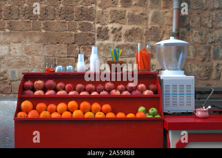 juice bar at the street - fresh fruits juices chilled in plastic cups, a popular street food in Akko city in Israel - Stock Photo