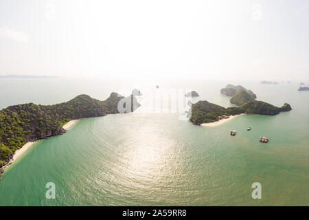 Aerial view Monkey Island in Lan Ha Bay, Ha Long Cat Ba, unique limestone rock islands and karst formation peaks in the sea, famous tourism destinatio - Stock Photo