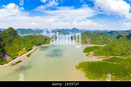 Aerial view of Ha Long Bay Cat Ba island, unique limestone rock islands and karst formation peaks in the sea, famous tourism destination in Vietnam. S - Stock Photo