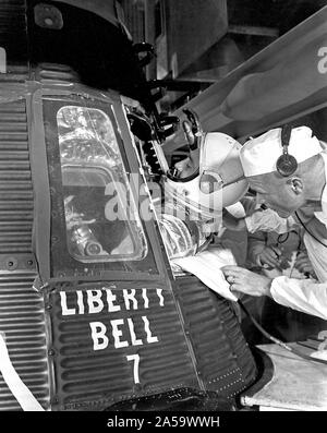 Astronaut Grissom, Vrgil entering Mercury-Redstone Capsule, Liberty bell 7, Assisted by Astronaut Glenn, John MR-4 Mission Launch On July 21, 1961. - Stock Photo