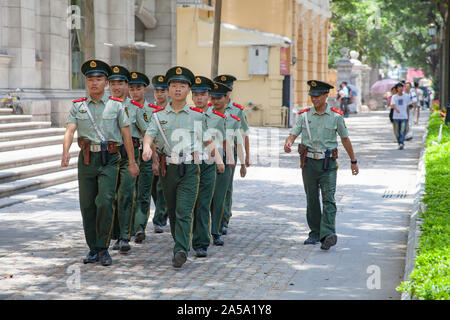 Young trainees marching through the street in Guangzhou, China. - Stock Photo