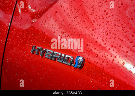 Berlin, Germany - September 28, 2019: Emblem of HYBRID on a ecofriendly car. - Stock Photo