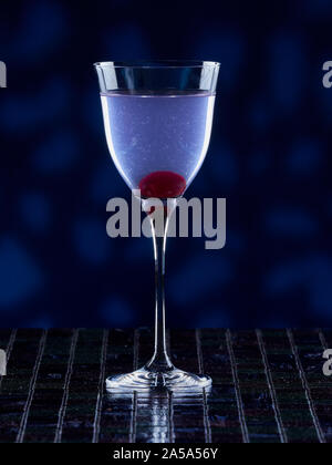 Aviation cocktail on blue background - Stock Photo