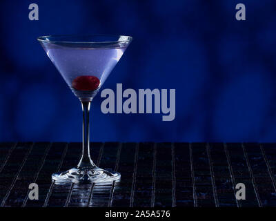 Aviation cocktail on blue background, copy space on the right side - Stock Photo