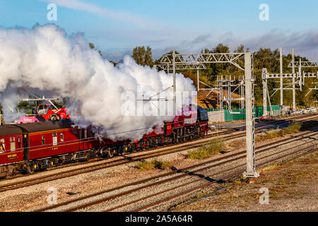 Northamptonshire, UK. 19th October 2019. Steam locomotive 46233 Duchess of Sutherland and The Yorkshireman Railtour passes through Northamptonshire near Isham at 0909 this morning, between Wellingborough and Kettering. The Duchess of Sutherland was built in 1938 as a high speed passenger train, carrying passengers between London Euston and Glasgow Central. Credit: Keith J Smith./Alamy Live News - Stock Photo