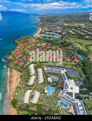 An aerial view of the Kea Lani Hotel looking north past Wailea Point to the Four Seasons and Grand Wailea Hotels, South Maui, Hawaii, USA. - Stock Photo