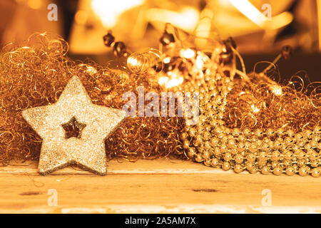 silver pearl necklace, light in gold warm light and silver star - Stock Photo