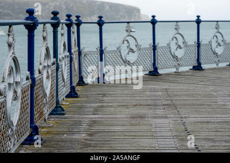 Swanage Pier, Dorset UK, photographed on a cold, windy autumn day. - Stock Photo