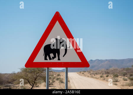 Elephant Crossing Danger Road Sign in Namibia, Triangle Shape - Stock Photo