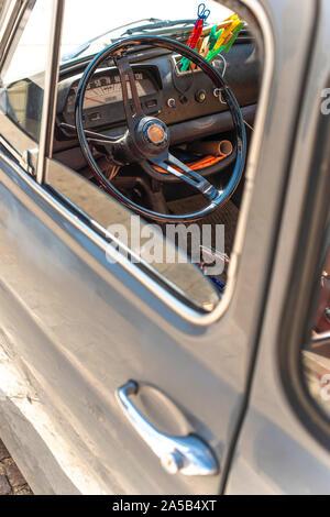 Steering wheel on vintage car. View from the door window. Opened window on old vintage car. - Stock Photo