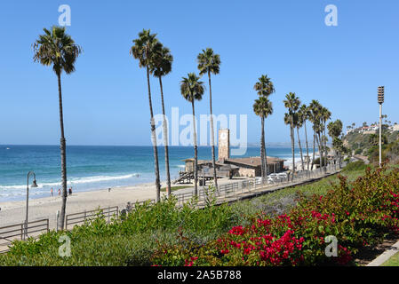 SAN CLEMENTE, CALIFORNIA - 18 OCT 2019: The ocean and beach seen from Parque del Mar with clock tower and train tracks. - Stock Photo