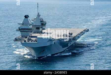The Royal Navy aircraft carrier HMS Queen Elizabeth during operations off the coast of Canada October 17, 2019 in the Atlantic Ocean. HMS Queen Elizabeth, is the largest warship ever built by the Royal Navy and is currently deployed in support of exercise WESTLANT 19. Stock Photo