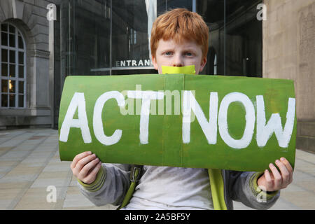 Manchester, UK.19th October, 2019.  A small group of climate protesters are holding a one hour silent protest to raise awareness of what they say is a lack of action taken by Manchester City Council despite declaring a climate emergency earlier in the year. St Peters Square, Manchester, Lancashire, UK. Credit: Barbara Cook/Alamy Live News - Stock Photo