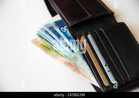 Israeli New Sheqel in the wallet on the table , on white background . - Stock Photo