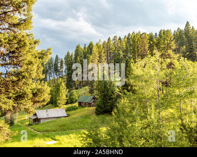 Abandoned log buildings in western ghost town. - Stock Photo