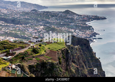 Spectacular view from the Cabo Girão Skywalk, a glass observation deck at 580 meters above sea level, towards Funchal, Madeira Island, Portugal.