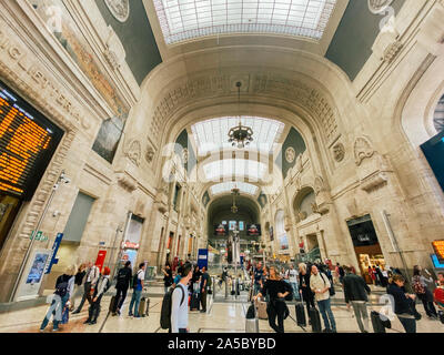 September 27, 2019. Arrival hall Milano Centrale railway stration of Milan, Italy. Milano Centrale Railway Station. Traveling people inside the