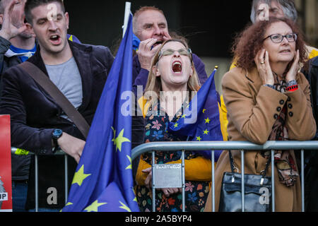 London, UK, 19 Oct 2019. Protesters shout outside Parliament. The 'People's Vote March' finishes its route through central London in Parliament Square, as hundreds of thousands protest for a final say in the Brexit deal. - Stock Photo
